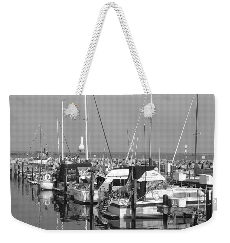 Sailboats Weekender Tote Bag featuring the photograph Boats And Reflections B-w by Anita Burgermeister