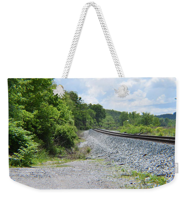 Railroad Weekender Tote Bag featuring the photograph Bobby Mackey's Railroad by Kayla Chapel