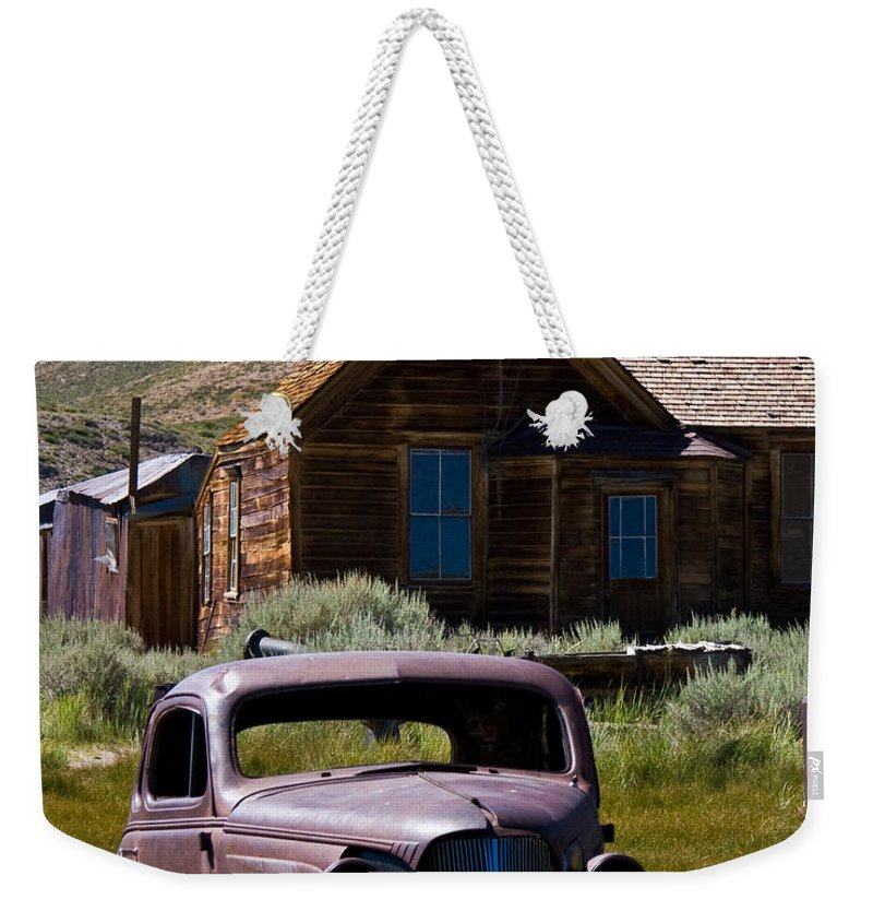 Bodies Finest Weekender Tote Bag featuring the photograph Bodies Finest by Chris Brannen