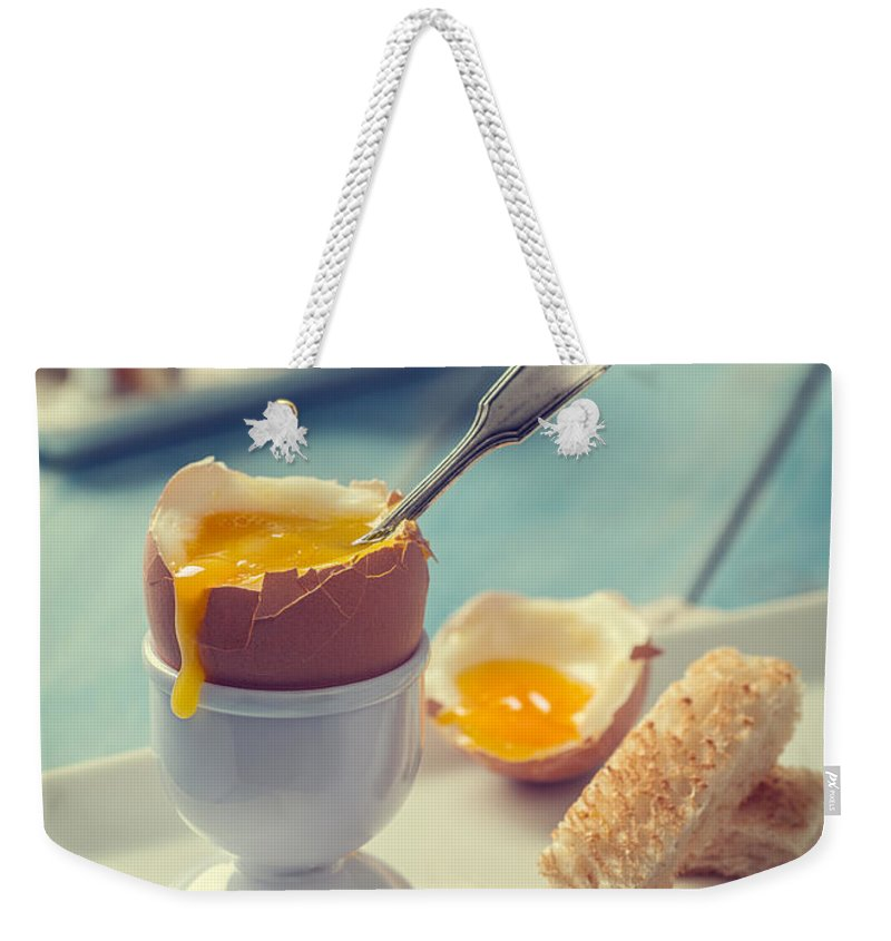 Soft Weekender Tote Bag featuring the photograph Boiled Egg With Spoon by Amanda Elwell