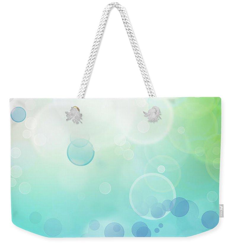 Green Weekender Tote Bag featuring the digital art Bokeh Blurs by Les Cunliffe