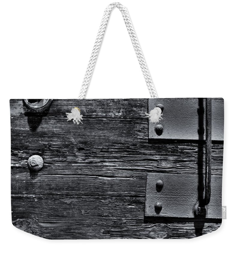 Wood Weekender Tote Bag featuring the photograph Bolted Wood by Scott Wyatt