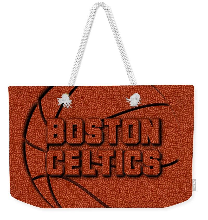 Celtics Weekender Tote Bag featuring the photograph Boston Celtics Leather Art by Joe Hamilton