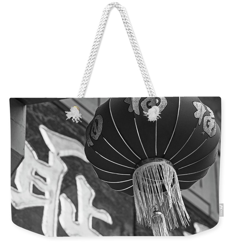 Boston Weekender Tote Bag featuring the photograph Boston Chinatown Lantern Boston Ma Black And White by Toby McGuire