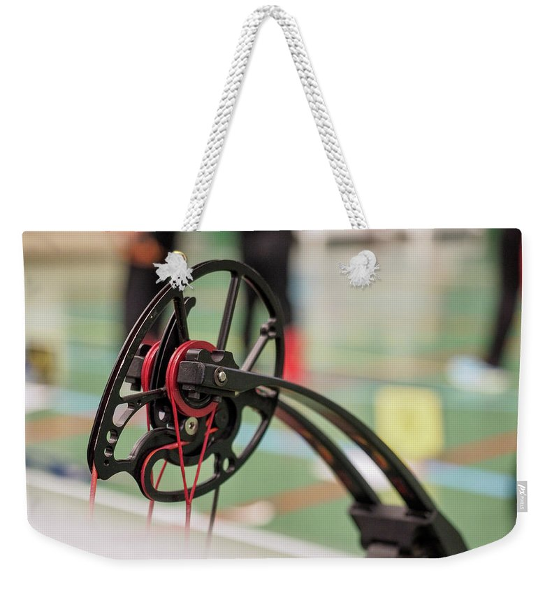 Bow Weekender Tote Bag featuring the photograph Bow by Hector Lacunza