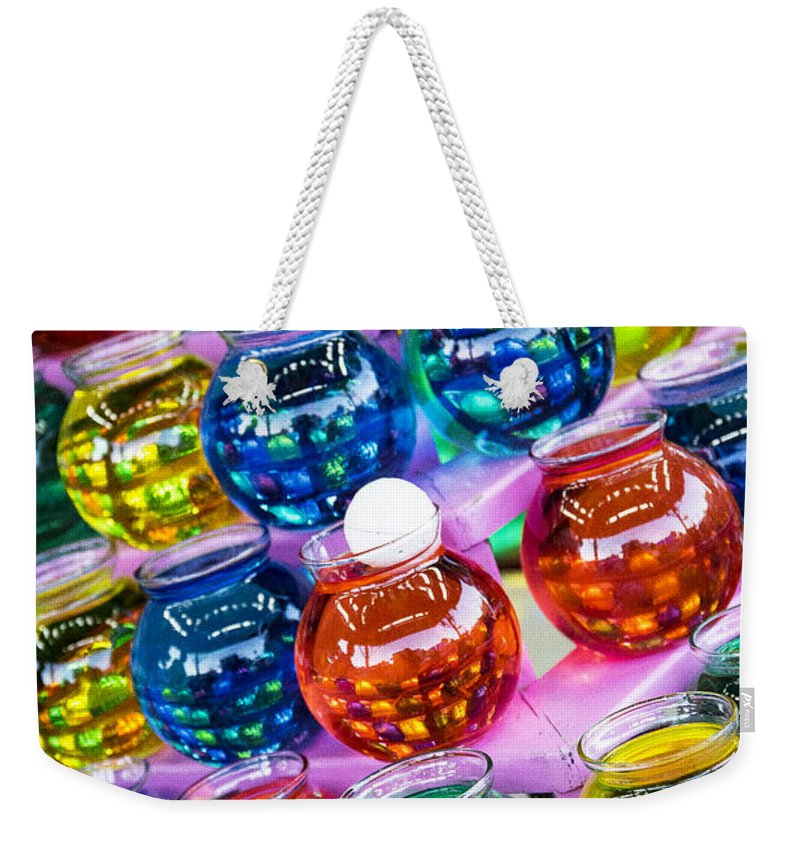 Ping Weekender Tote Bag featuring the photograph Bowls by Pablo Rosales
