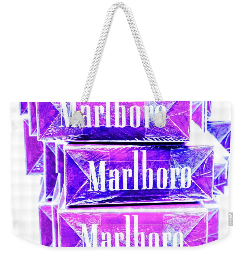 Blue Weekender Tote Bag featuring the photograph Boxed Cigarettes Stacked In Ultraviolet by YoPedro