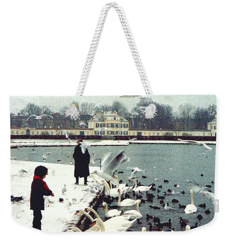 Swans Weekender Tote Bag featuring the photograph Boy Feeding Swans- Germany by Nancy Mueller