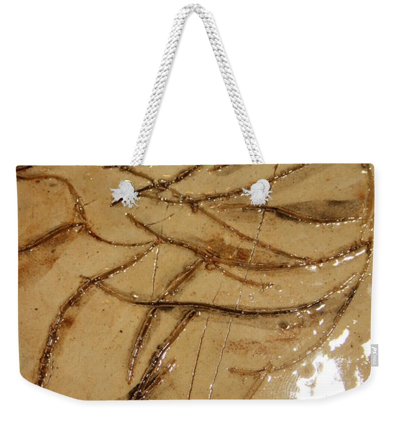 Gloria Ssali Weekender Tote Bag featuring the ceramic art Brave Tile by Gloria Ssali