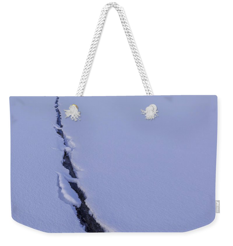 Breaking Ice Weekender Tote Bag featuring the photograph Breaking Ice by Chad Dutson
