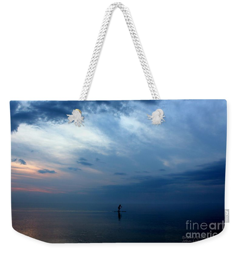 Grand Bend Weekender Tote Bag featuring the photograph Brian's Evening Workout 4 by John Scatcherd