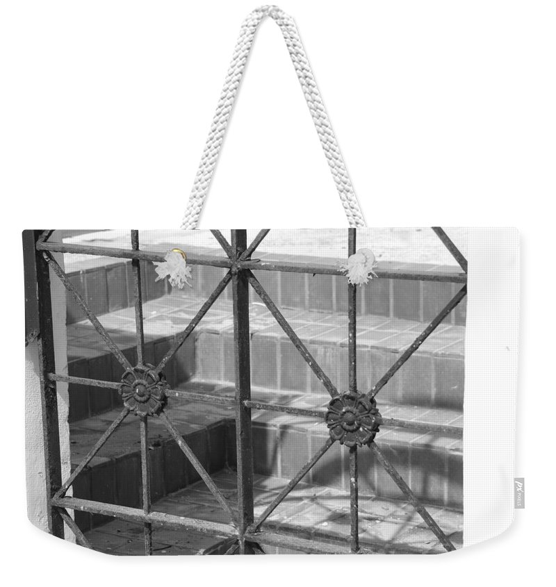 Black And White Weekender Tote Bag featuring the photograph Bricks And Iron by Rob Hans