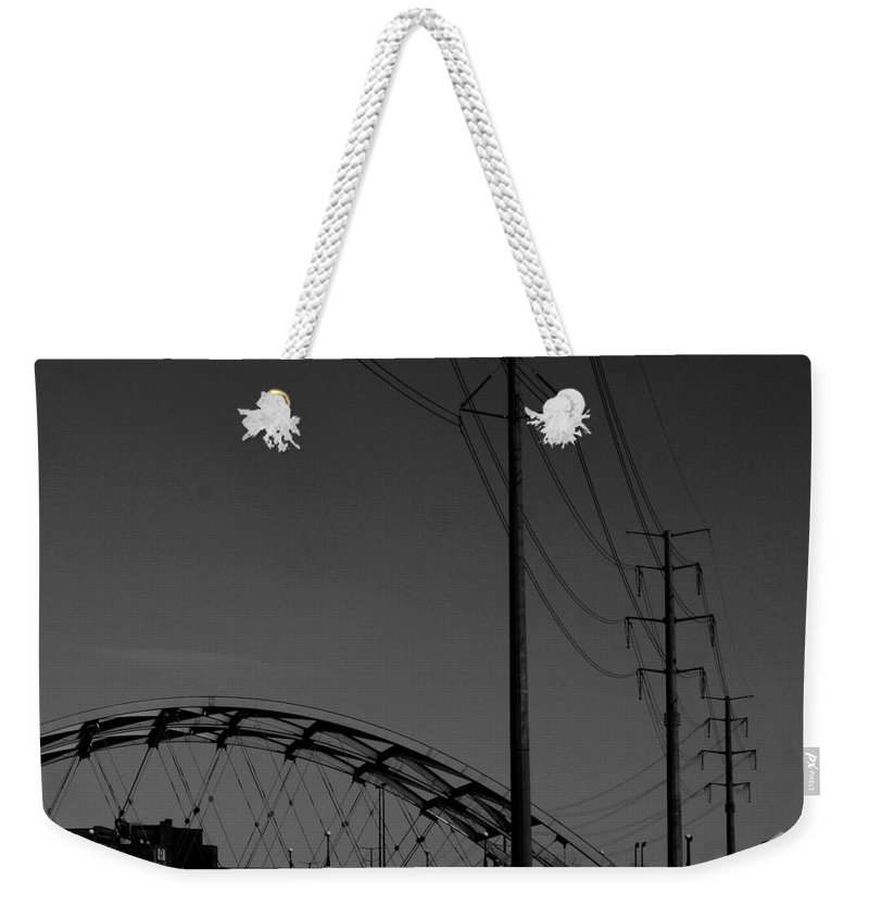Metal Structures Weekender Tote Bag featuring the photograph Bridge And Power Poles At Dusk by Angus Hooper Iii