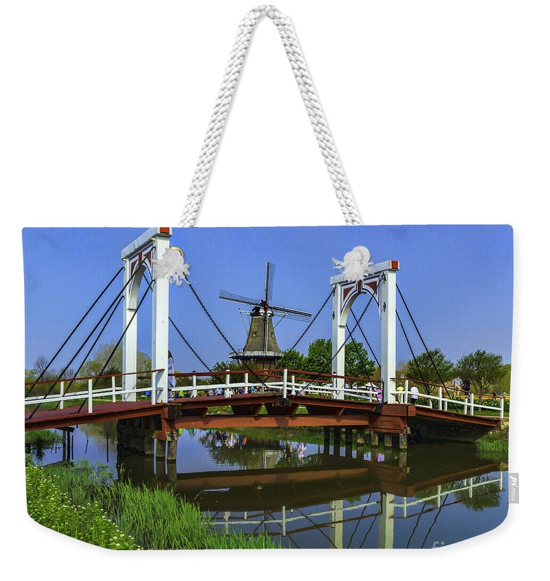 Holland Weekender Tote Bag featuring the photograph Bridge And Windmill by Nick Zelinsky
