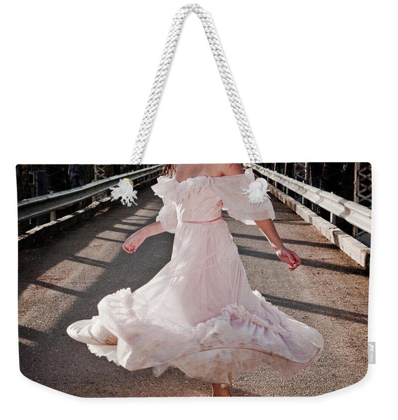 Dance Weekender Tote Bag featuring the photograph Bridge Dancer by Scott Sawyer