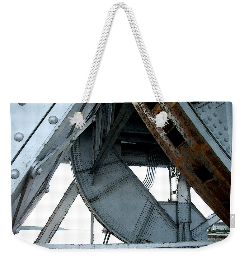 Steel Weekender Tote Bag featuring the photograph Bridge Gears by Tim Nyberg