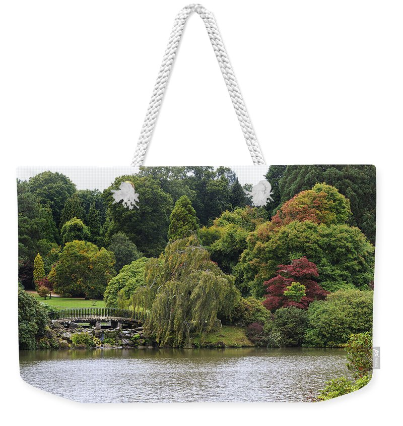 Autumn Weekender Tote Bag featuring the photograph Bright Colors Of Autumn Trees On A Lake , Autumn Landscape. by Chris Smith