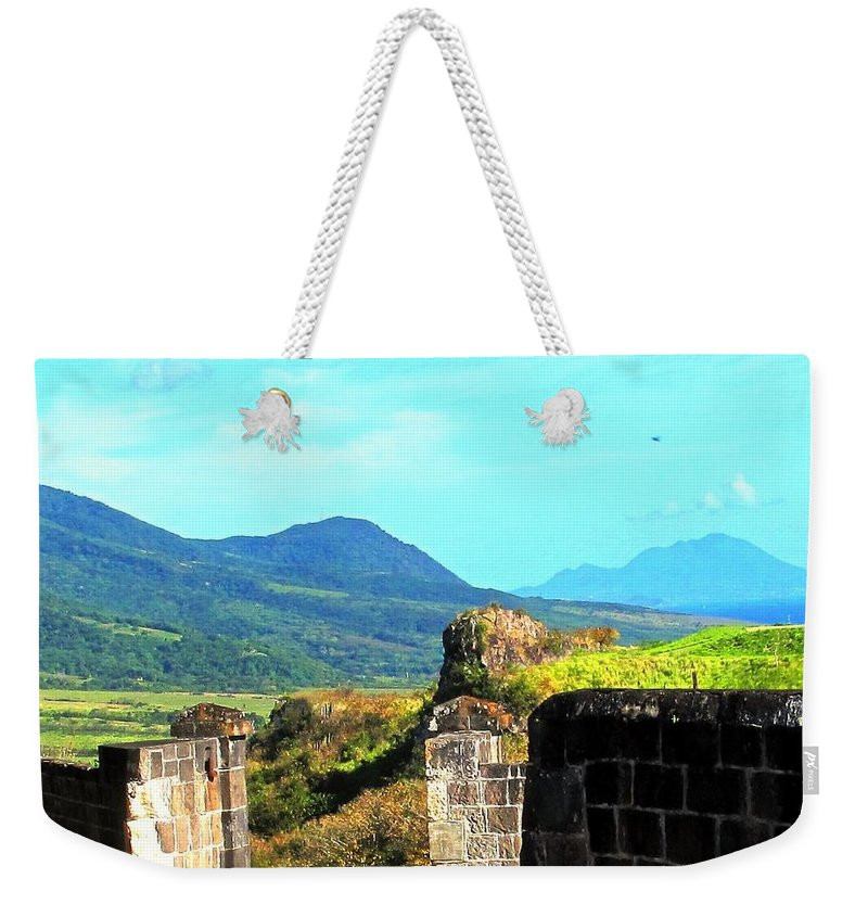St Kitts Weekender Tote Bag featuring the photograph Brimstone Towards Nevis by Ian MacDonald