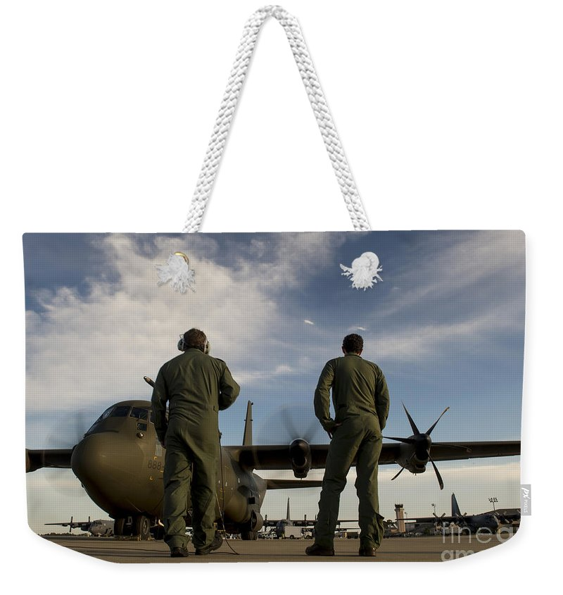 Exercise Emerald Warrior Weekender Tote Bag featuring the photograph British Royal Air Force C-130j by Stocktrek Images
