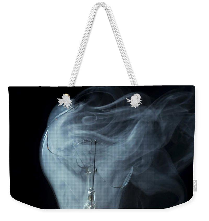 Light Weekender Tote Bag featuring the photograph Broken Light Bulb by Michal Boubin
