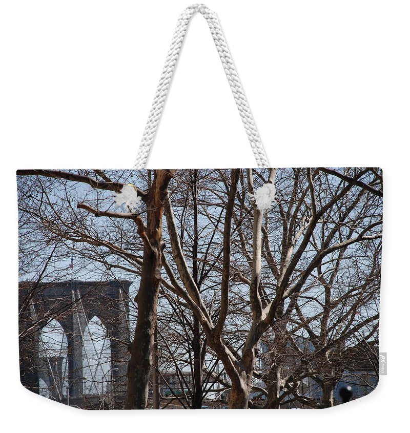 Architecture Weekender Tote Bag featuring the photograph Brooklyn Bridge Thru The Trees by Rob Hans