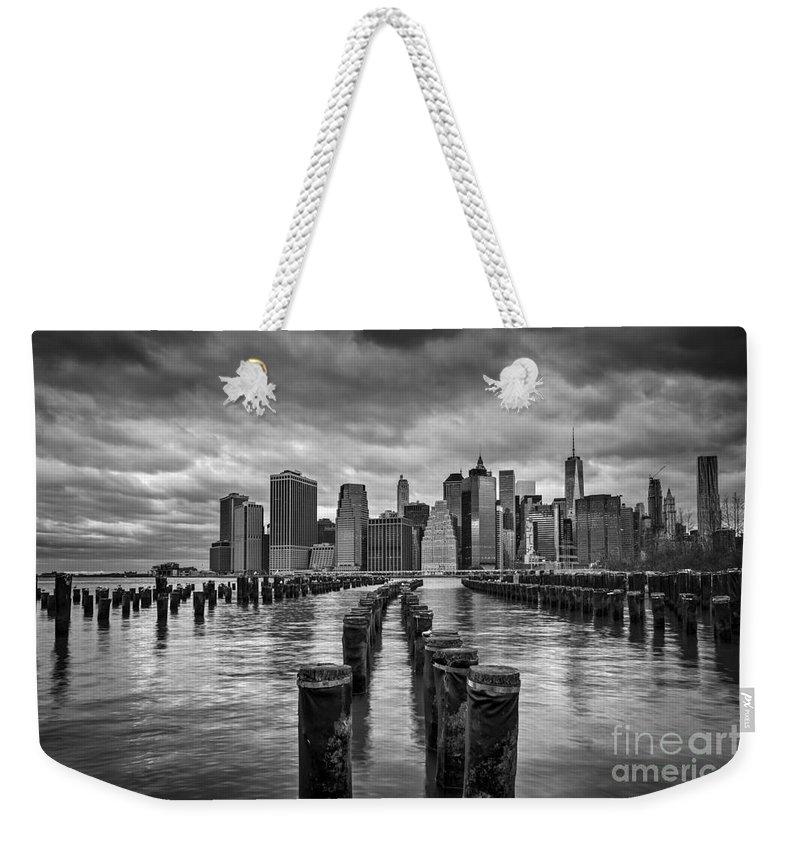 Brooklyn Bridge Park Weekender Tote Bag featuring the photograph Brooklyn Pilings Bw by Michael Ver Sprill
