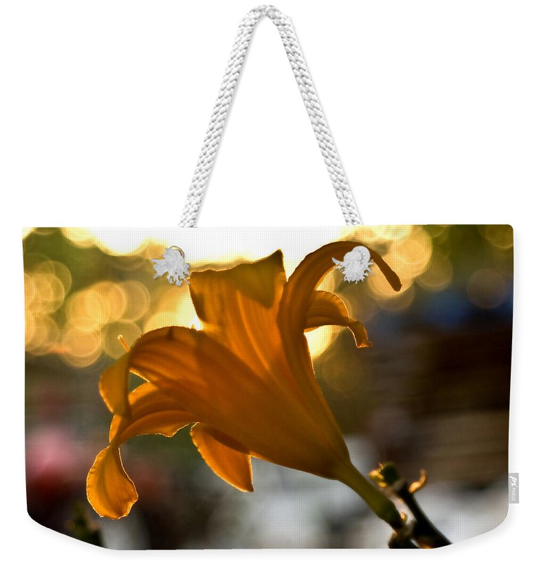 Bubble Blowing Flower Weekender Tote Bag featuring the photograph Bubble Blowing Flower by Chris Brannen