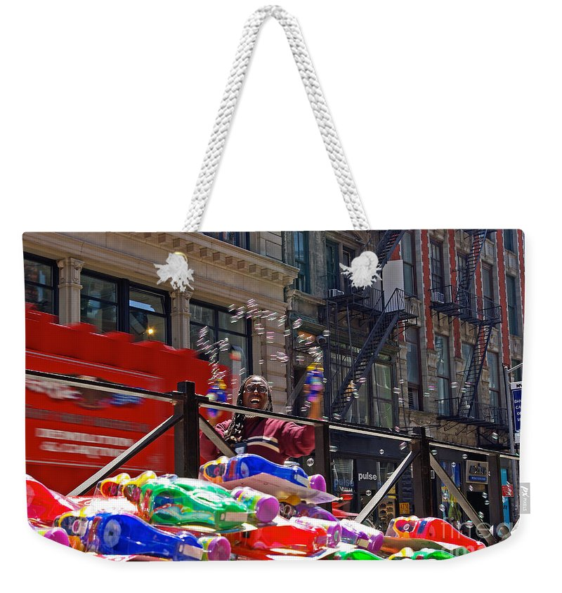 Bubbles Weekender Tote Bag featuring the photograph Bubble Gun Seller In New York by Zal Latzkovich
