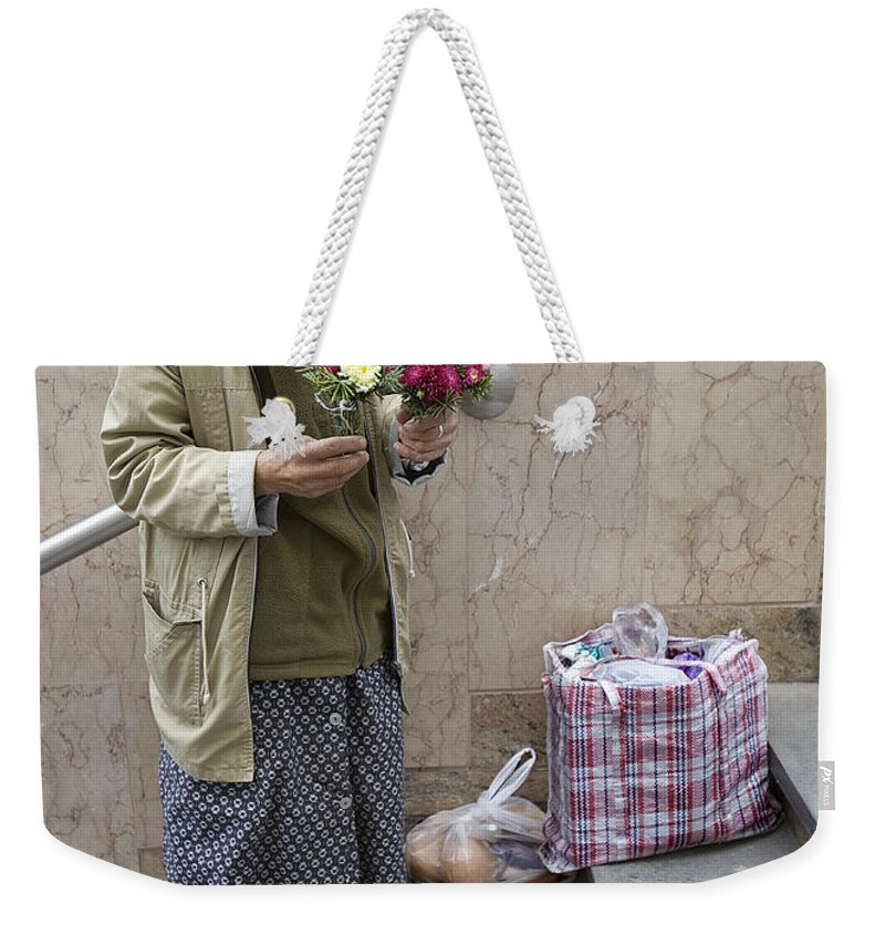 Budapest Weekender Tote Bag featuring the photograph Budapest Flower Woman by Madeline Ellis