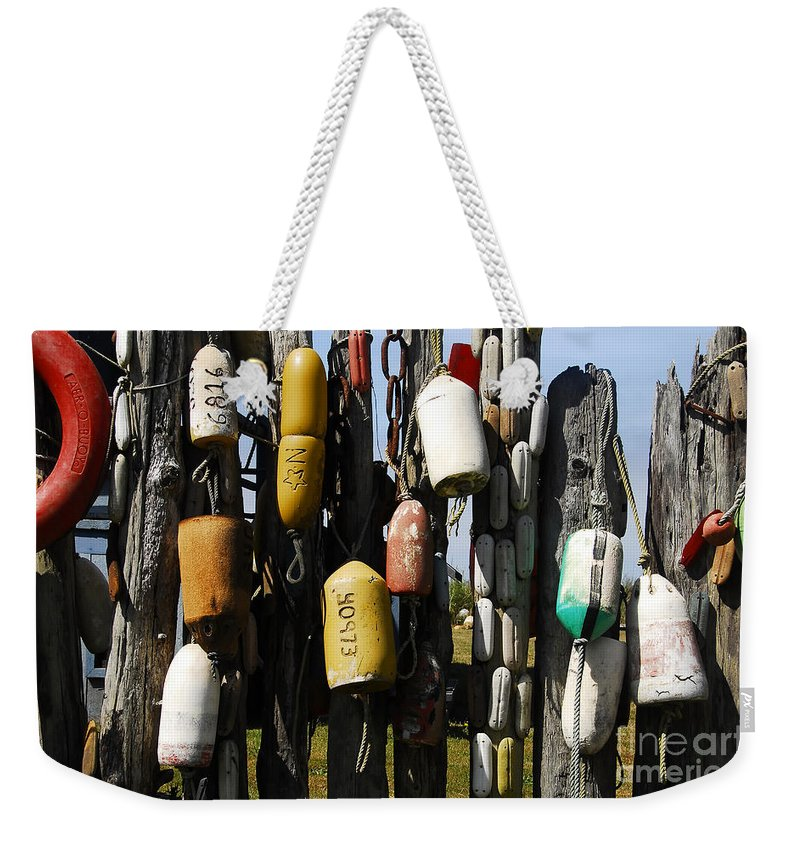 Buoys Weekender Tote Bag featuring the photograph Buoys by David Lee Thompson