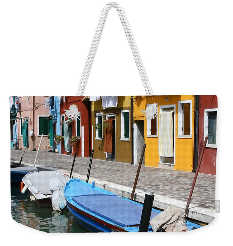Burano Weekender Tote Bag featuring the photograph Burano Corner With Laundry by Donna Corless