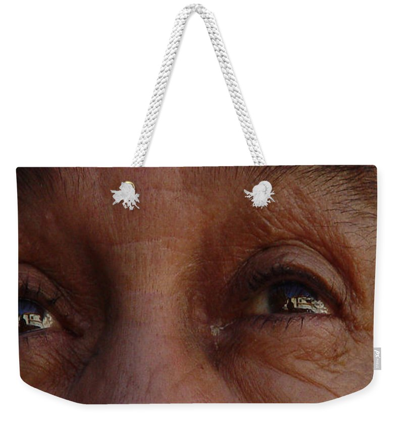 Eyes Weekender Tote Bag featuring the photograph Burned Eyes by Peter Piatt