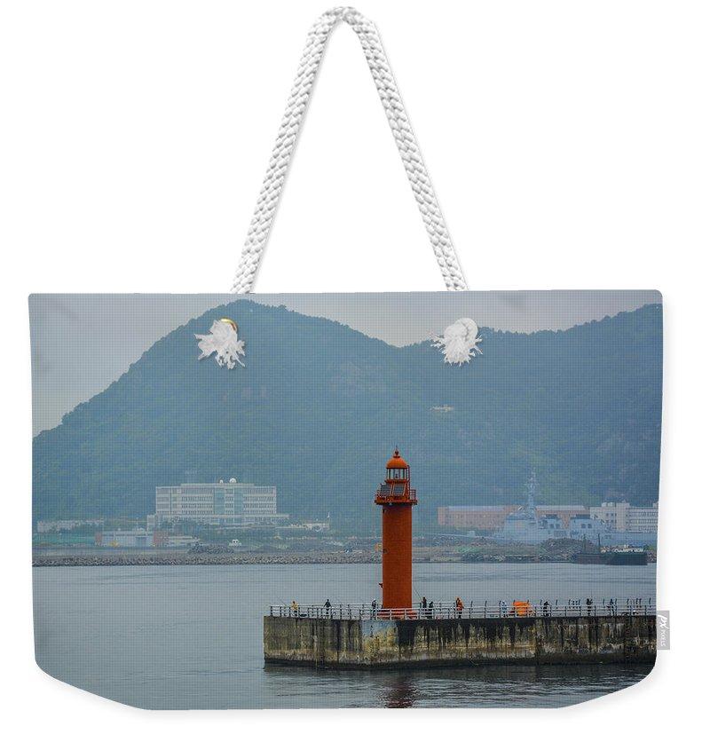 Lighthouse; Busan; Korea; Southkorea; Ocean; Seaside; Cruise; Ship; Port; Fishing Weekender Tote Bag featuring the photograph Busan Lighthouse by John Lillis