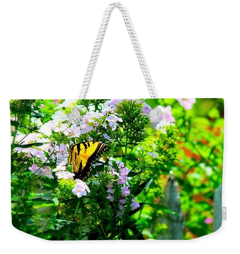 Garden Weekender Tote Bag featuring the photograph Butterfly In A Garden by Teresa Self