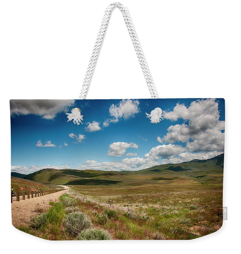 Weekender Tote Bag featuring the photograph By Myself by Jason Branum