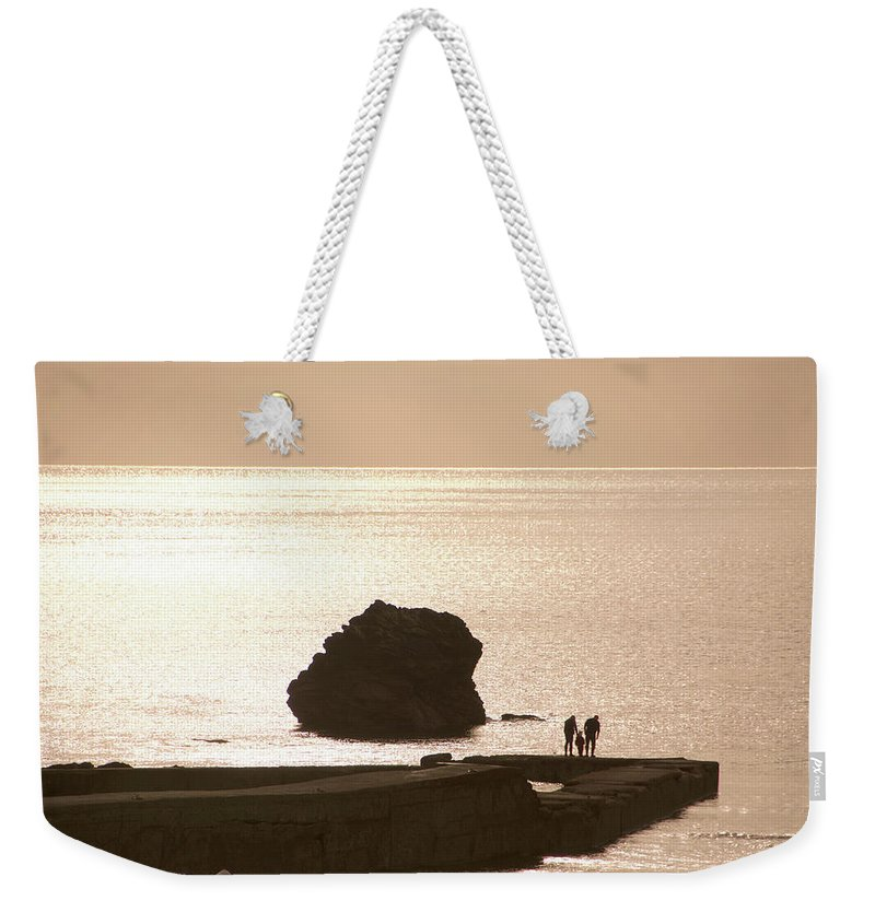 Couple Weekender Tote Bag featuring the photograph By The Sea by Phil Child