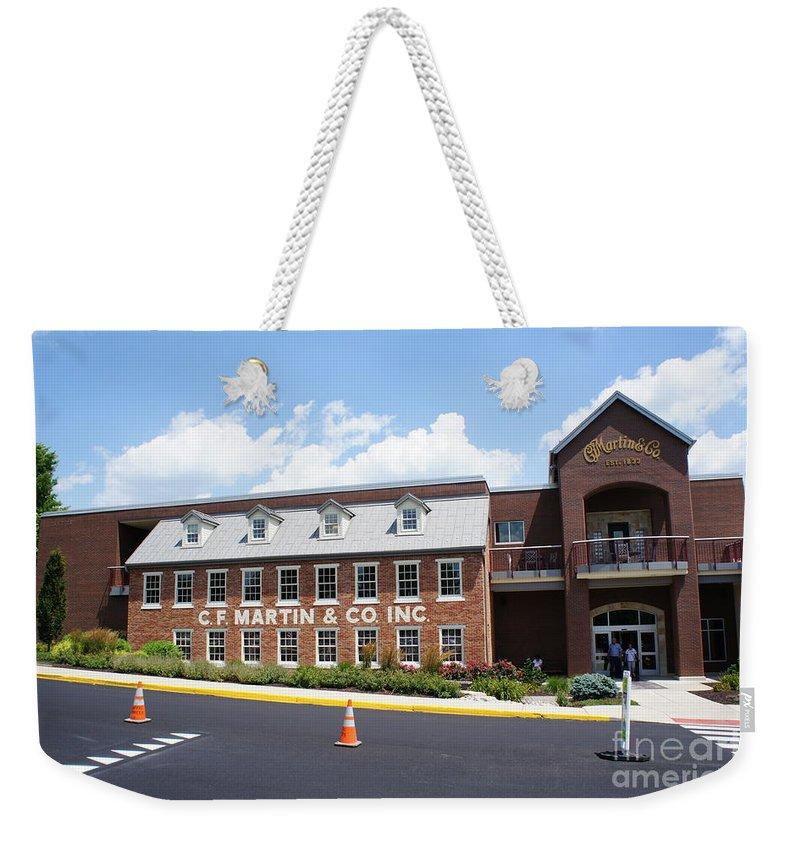 C. F. Martin Guitar Factory Pennsylvania Weekender Tote Bag featuring the photograph C. F. Martin by Bob Bennett
