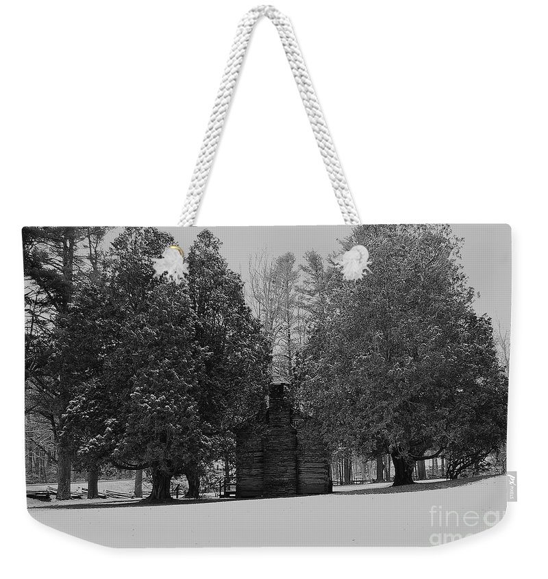 Snow Weekender Tote Bag featuring the photograph Cabin Between The Cedars by Eric Liller