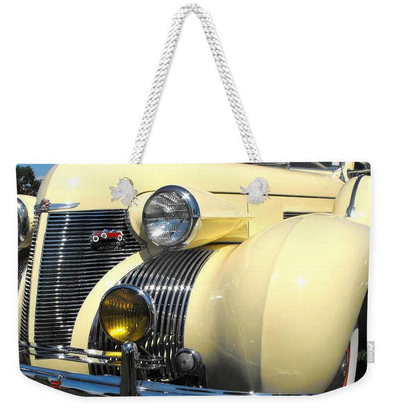 Cadillac Weekender Tote Bag featuring the photograph Cadillac Fleetwood by Neil Zimmerman