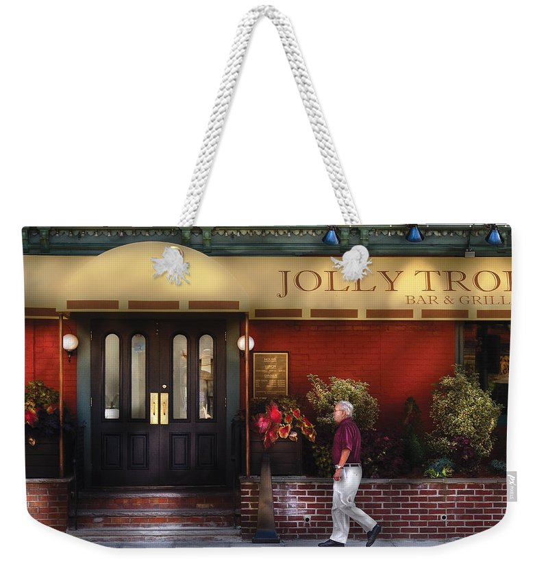 Savad Weekender Tote Bag featuring the photograph Cafe - Jolly Trolley by Mike Savad