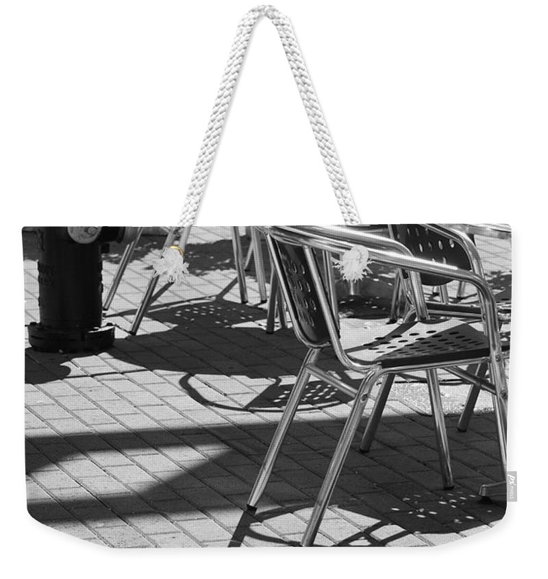 Fire Hydrant Weekender Tote Bag featuring the photograph Cafe Hydrant by Rob Hans