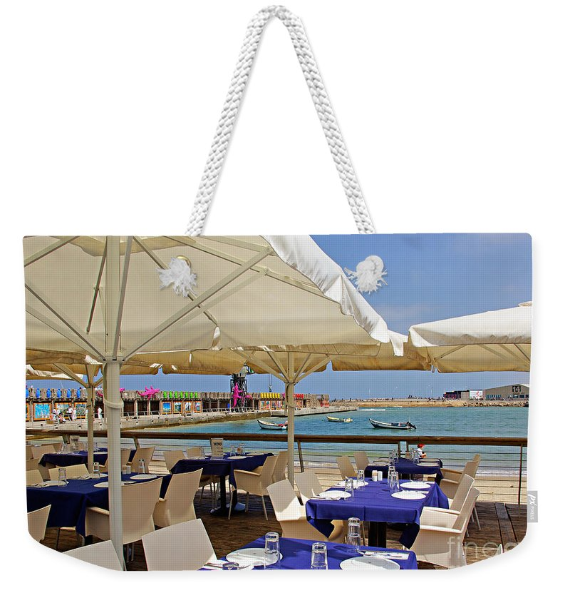Cafe Weekender Tote Bag featuring the photograph Cafe In White And Purple by Zal Latzkovich