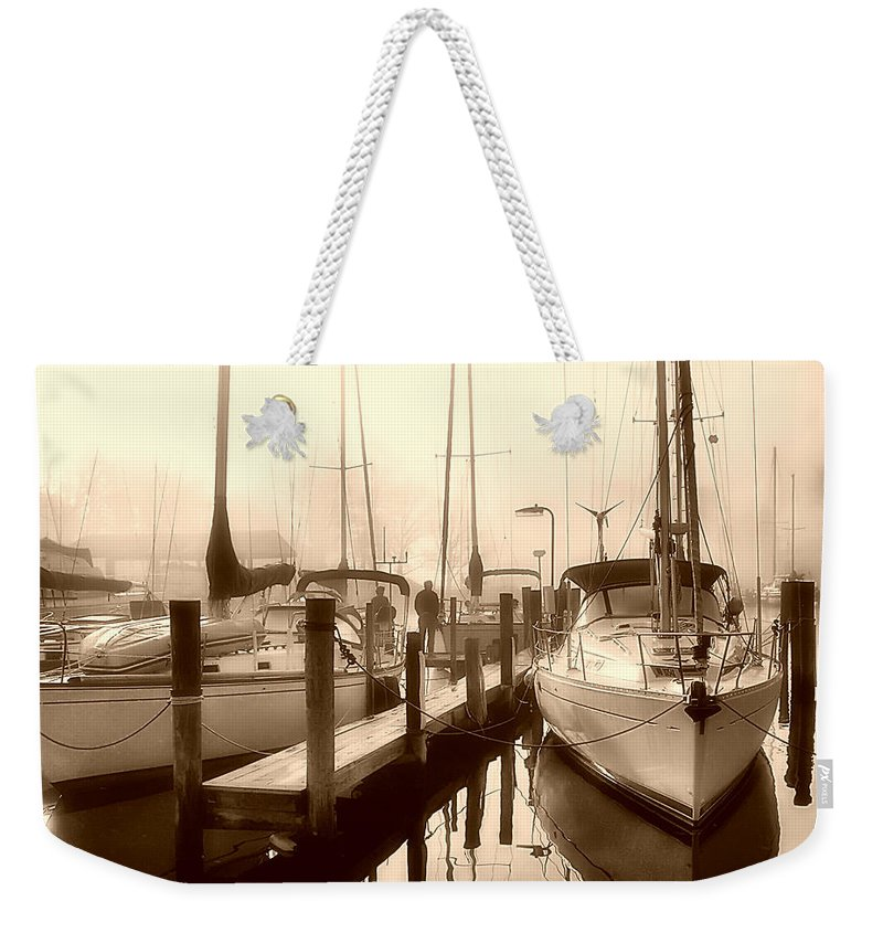 2d Weekender Tote Bag featuring the photograph Calmly Docked by Brian Wallace