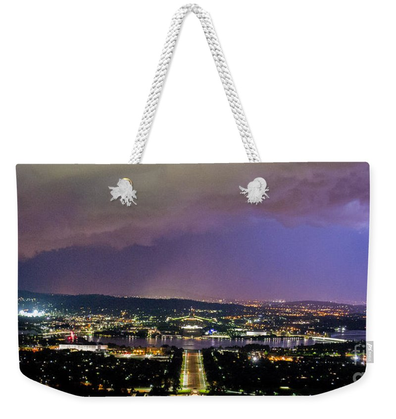 Canberra Weekender Tote Bag featuring the photograph Canberra Stormy Night by Angela DeFrias