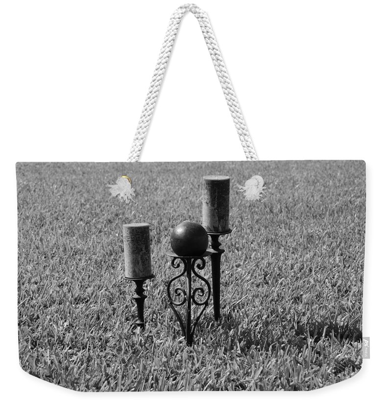 Black And White Weekender Tote Bag featuring the photograph Candles In Grass by Rob Hans