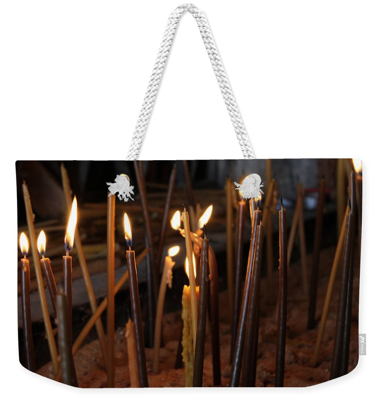 Candle Weekender Tote Bag featuring the photograph Candles by Munir Alawi