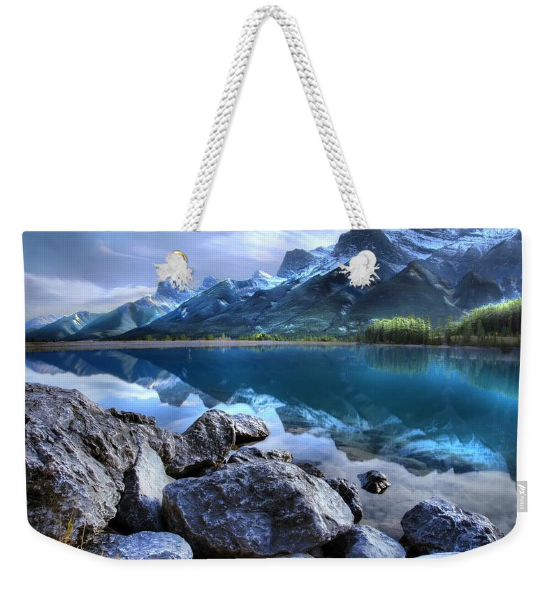 Canmore Weekender Tote Bag featuring the photograph Canmore Reservoir Under A Setting Sun by Ken McMullen