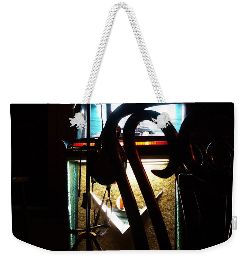 Music Weekender Tote Bag featuring the photograph Canned Music by Tim Nyberg