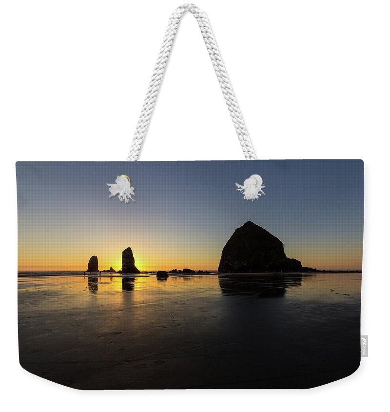 Cannon Weekender Tote Bag featuring the photograph Cannon Beach Low Tide Sunset by David Gn