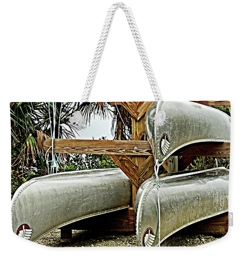 Boats Weekender Tote Bag featuring the photograph Canoes At Canaveral National Seashore by James Hoolsema